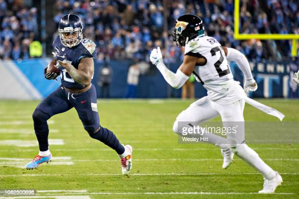 Derrick Henry of the Tennessee Titans runs the ball and is tackled by Jalen Ramsey of the Jacksonville Jaguars at Nissan Stadium on December 6 2018...