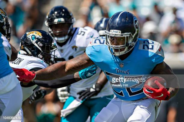 Derrick Henry of the Tennessee Titans runs the ball during a game against the Jacksonville Jaguars at TIAA Bank Field on September 23 2018 in...