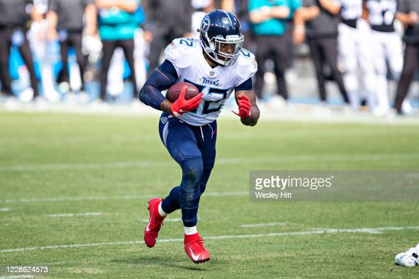 Derrick Henry of the Tennessee Titans runs the ball during the first half of a game against the Jacksonville Jaguars at Nissan Stadium on September...