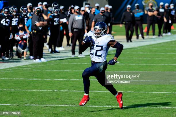 Derrick Henry of the Tennessee Titans runs the ball for a touchdown against the Jacksonville Jaguars in the second quarter at TIAA Bank Field on...