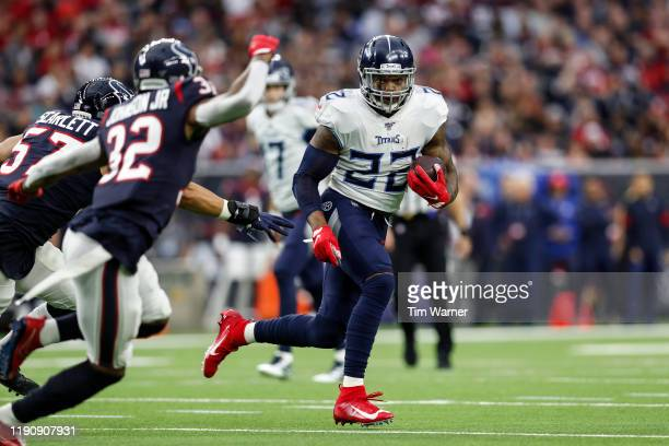 Derrick Henry of the Tennessee Titans runs the ball in the first half against the Houston Texans at NRG Stadium on December 29, 2019 in Houston,...