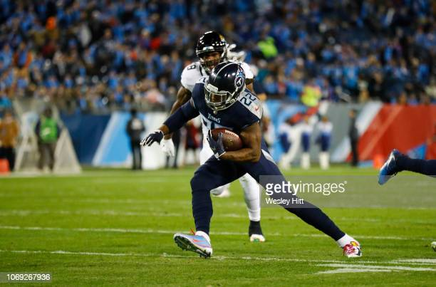 Derrick Henry of the Tennessee Titans runs with the ball against the Jacksonville Jaguars during the first quarter at Nissan Stadium on December 6...