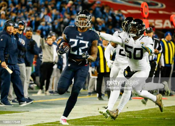 Derrick Henry of the Tennessee Titans runs with the ball against the Jacksonville Jaguars during the third quarter at Nissan Stadium on December 6...