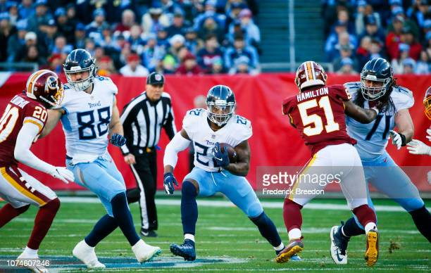 Derrick Henry of the Tennessee Titans runs with the ball against the Washington Redskins during the first quarter at Nissan Stadium on December 22...