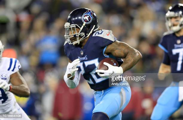 Derrick Henry of the Tennessee Titans runs with the ball against the Indianapolis Colts at Nissan Stadium on December 30 2018 in Nashville Tennessee