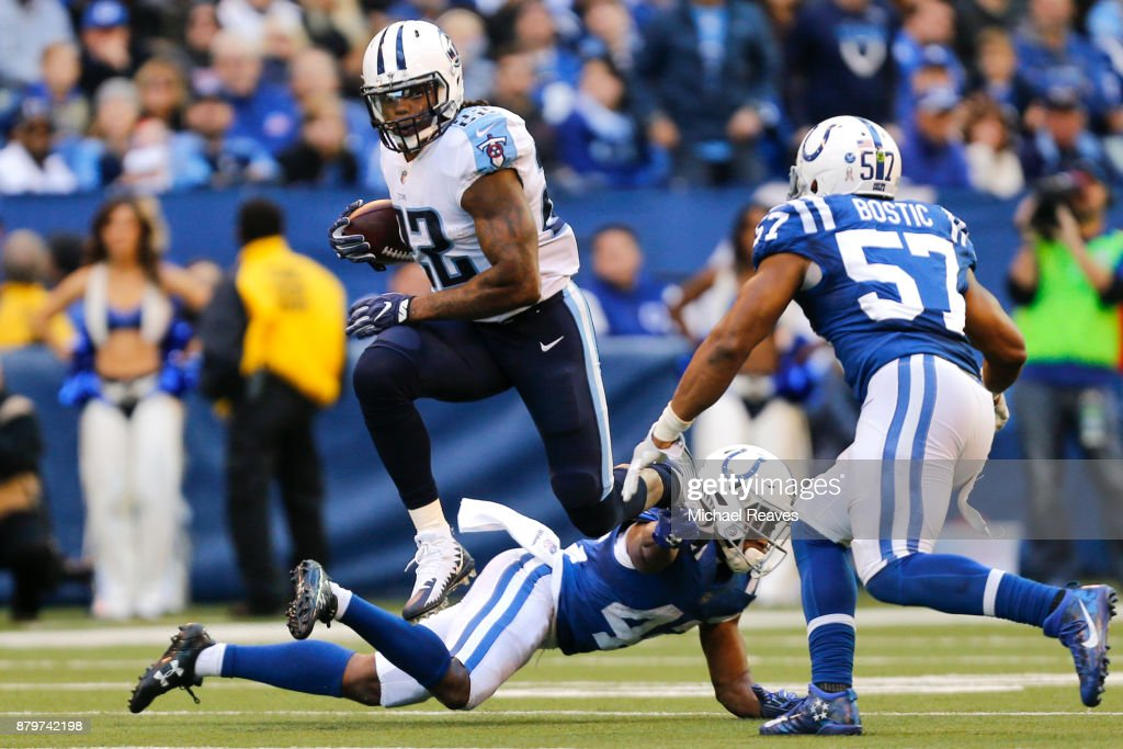Derrick Henry #22 of the Tennessee Titans runs with the ball against the Indianapolis Colts at Lucas Oil Stadium on November 26, 2017 in Indianapolis, Indiana.
