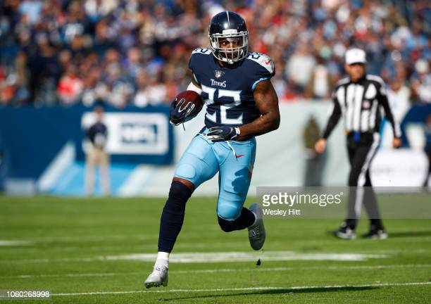 Derrick Henry of the Tennessee Titans runs with the ball during the first quarter against the New England Patriots at Nissan Stadium on November 11...