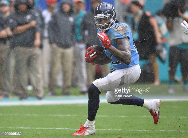 Derrick Henry of the Tennessee Titans runs with the ball in the first quarter against the Miami Dolphins at Hard Rock Stadium on September 9 2018 in...