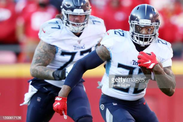 Derrick Henry of the Tennessee Titans runs with the ball in the first half against the Kansas City Chiefs in the AFC Championship Game at Arrowhead...