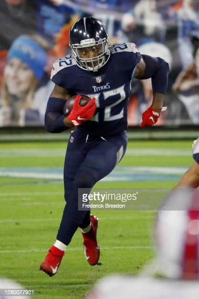 Derrick Henry of the Tennessee Titans runs with the ball in the second quarter against the Buffalo Bills at Nissan Stadium on October 13, 2020 in...