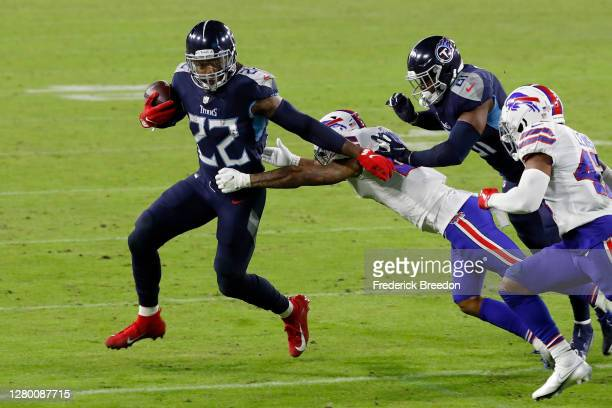 Derrick Henry of the Tennessee Titans runs with the ball in the third quarter against the Buffalo Bills at Nissan Stadium on October 13, 2020 in...