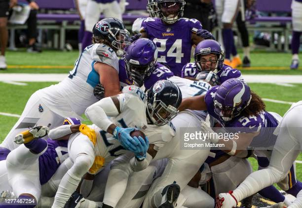 Derrick Henry of the Tennessee Titans runs with the ball on a fourth down play in the second quarter of the game against the Minnesota Vikings at...