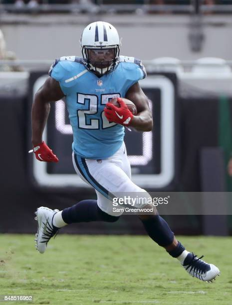 Derrick Henry of the Tennessee Titans runs with the football against the Jacksonville Jaguars during the second half of their game at EverBank Field...