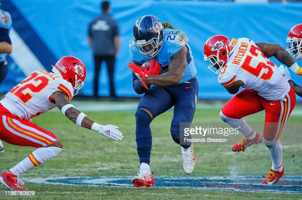Derrick Henry of the Tennessee Titans rushes against Juan Thornhill and Anthony Hitchens of the Kansas City Chiefs during the second half at Nissan...