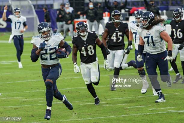 Derrick Henry of the Tennessee Titans rushes before scoring the game-winning overtime touchdown against the Baltimore Ravens at M&T Bank Stadium on...