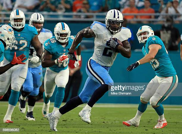 Derrick Henry of the Tennessee Titans rushes during a preseason game against the Miami Dolphins at Hard Rock Stadium on September 1 2016 in Miami...