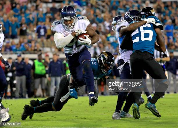 Derrick Henry of the Tennessee Titans rushes for a touchdown during a game against the Jacksonville Jaguars at TIAA Bank Field on September 19, 2019...