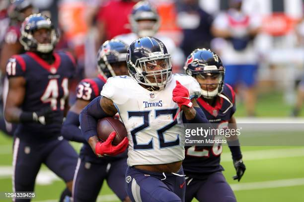 Derrick Henry of the Tennessee Titans rushes for a touchdown during the first half against the Houston Texans at NRG Stadium on January 03, 2021 in...