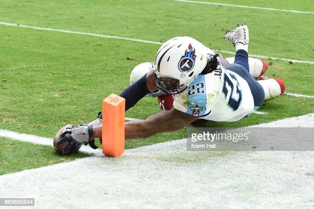 Derrick Henry of the Tennessee Titans rushes the football for a six yard touchdown against the Arizona Cardinals in the first half at University of...