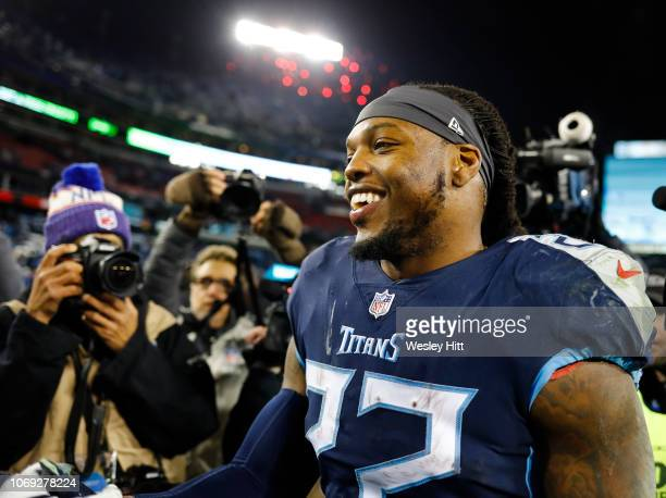 Derrick Henry of the Tennessee Titans shakes hands with members of the Jacksonville Jaguars after the game at Nissan Stadium on December 6 2018 in...