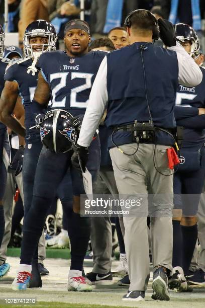 Derrick Henry of the Tennessee Titans speaks to head coach Mike Vrabel after breaking the franchise record for yards in a game against the...