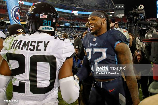 Derrick Henry of the Tennessee Titans speaks to Jalen Ramsey of the Jacksonville Jaguars after a Titans victory at Nissan Stadium on December 6 2018...