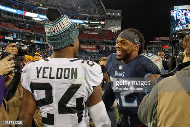 Derrick Henry of the Tennessee Titans speaks to TJ Yeldon of the Jacksonville Jaguars after a Titans victory at Nissan Stadium on December 6 2018 in...