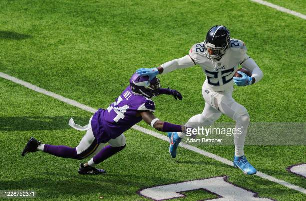 Derrick Henry of the Tennessee Titans stiff arms Holton Hill of the Minnesota Vikings in the first quarter at U.S. Bank Stadium on September 27, 2020...