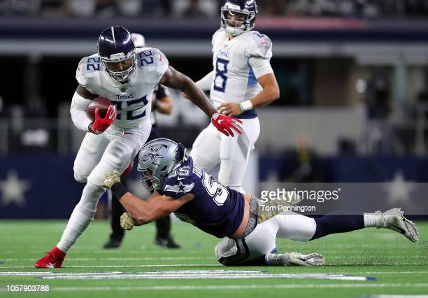 Derrick Henry of the Tennessee Titans tries to avoid a tackle by Leighton Vander Esch of the Dallas Cowboys in the fourth quarter of a football game...