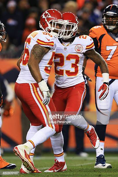 Derrick Johnson celebrates a fumble recovery with Kendrick Lewis of the Kansas City Chiefs in the first half against the Denver Broncos at Sports...