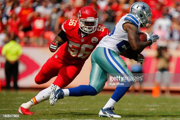 Derrick Johnson of the Kansas City Chiefs attempts to take down Lance Dunbar of the Dallas Cowboys in the third quarter on September 15 2013 at...