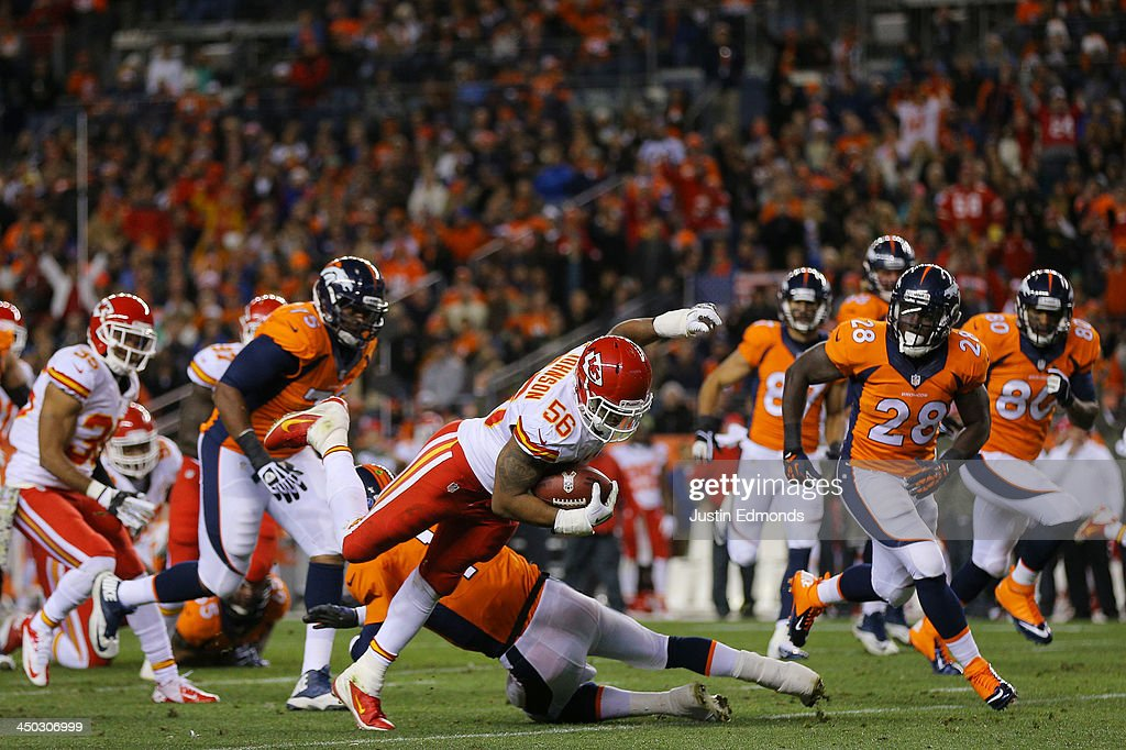 Derrick Johnson #56 of the Kansas City Chiefs is tackled by Peyton Manning #18 of the Denver Broncos after recovering a fumble in the first quarter at Sports Authority Field at Mile High on November 17, 2013 in Denver, Colorado.