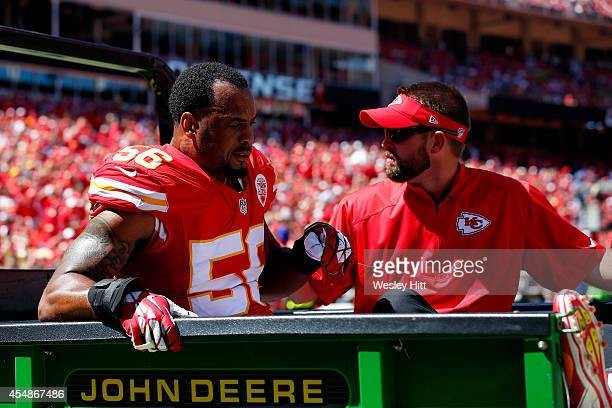 Derrick Johnson of the Kansas City Chiefs reacts as he is taken off the field during the first half of the game against the Tennessee Titans at...