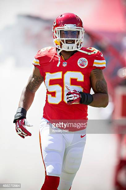 Derrick Johnson of the Kansas City Chiefs runs onto the field before a game against the Tennessee Titans at Arrowhead Stadium on September 7 2014 in...