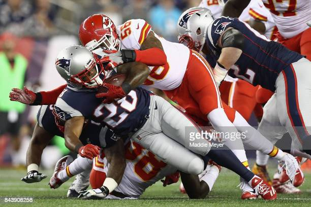 Derrick Johnson of the Kansas City Chiefs tackles James White of the New England Patriots during the first quarter of their game at Gillette Stadium...