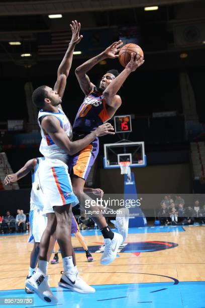 Derrick Jones Jr #10 of the North Arizona Suns shoots the ball against the Oklahoma City Blue during an NBA GLeague game on December 19 2017 at the...