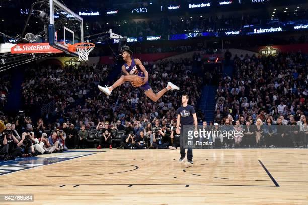 Derrick Jones Jr #10 of the Phoenix Suns dunks during the Verizon Slam Dunk Contest on State Farm AllStar Saturday Night as part of the 2017 NBA...