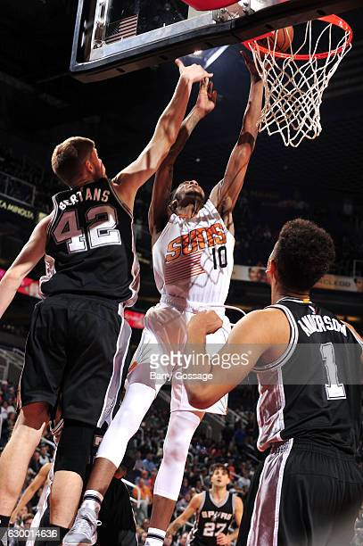 Derrick Jones Jr #10 of the Phoenix Suns goes for the dunk during the game against the San Antonio Spurs on December 15 2016 at US Airways Center in...