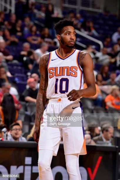 Derrick Jones Jr #10 of the Phoenix Suns handles the ball against the Utah Jazz on October 9 2017 at Talking Stick Resort Arena in Phoenix Arizona...