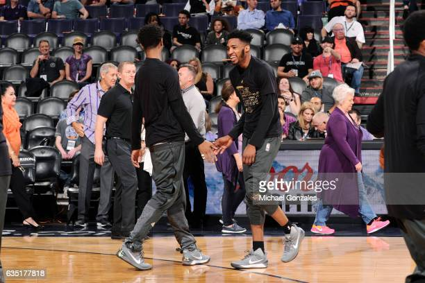 Derrick Jones Jr #10 of the Phoenix Suns high fives his teammate before the game against the New Orleans Pelicans on February 13 2017 at US Airways...