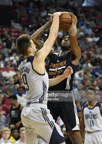 Derrick Jones Jr #10 of the Phoenix Suns is called for an offensive foul as Nicolas Brussino of the Dallas Mavericks defends during the 2017 Summer...