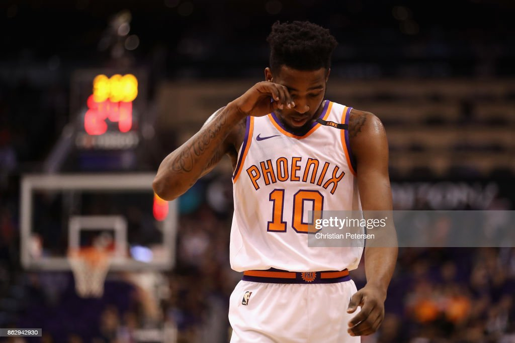 Derrick Jones Jr. #10 of the Phoenix Suns reacts as he walks down court during the second half of the NBA game against the Portland Trail Blazers at Talking Stick Resort Arena on October 18, 2017 in Phoenix, Arizona.