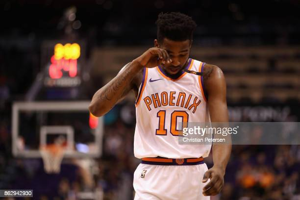 Derrick Jones Jr #10 of the Phoenix Suns reacts as he walks down court during the second half of the NBA game against the Portland Trail Blazers at...