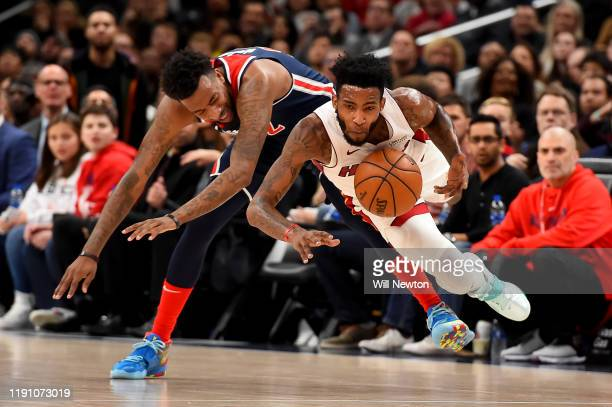 Derrick Jones Jr #5 of the Miami Heat and Jordan McRae of the Washington Wizards go after the ball during the first half at Capital One Arena on...