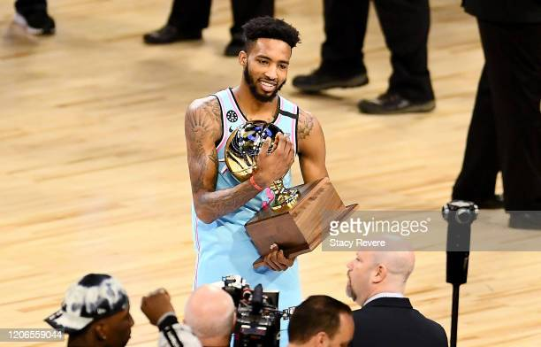 Derrick Jones Jr #5 of the Miami Heat celebrates with the trophy after winning the 2020 NBA AllStar ATT Slam Dunk Contest during State Farm AllStar...