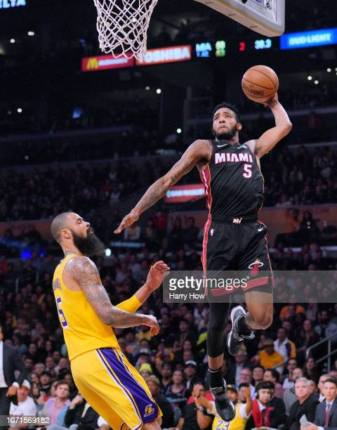 Derrick Jones Jr #5 of the Miami Heat dunks in front of Tyson Chandler of the Los Angeles Lakers during the first half at Staples Center on December...