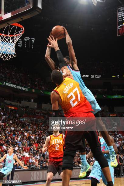 Derrick Jones Jr #5 of the Miami Heat dunks on Rudy Gobert of the Utah Jazz on December 23 2019 at American Airlines Arena in Miami Florida NOTE TO...
