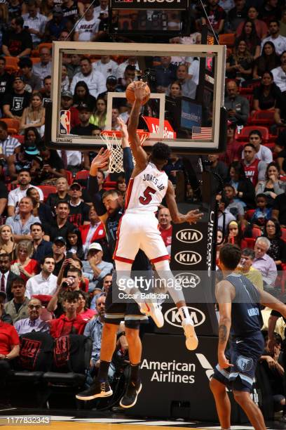 Derrick Jones Jr #5 of the Miami Heat dunks the ball against the Memphis Grizzlies on October 23 2019 at American Airlines Arena in Miami Florida...