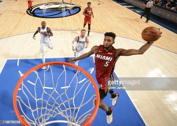 Derrick Jones Jr #5 of the Miami Heat dunks the ball against the Dallas Mavericks on December 14 2019 at the American Airlines Center in Dallas Texas...
