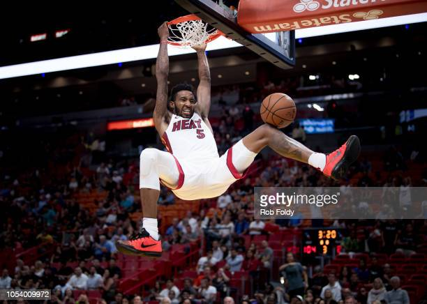 Derrick Jones Jr #5 of the Miami Heat dunks the ball during the game against the New Orleans Pelicans at American Airlines Arena on October 10 2018...